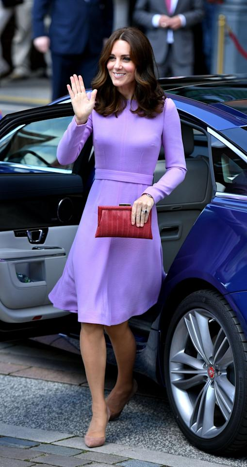 <p><b>For her final day of engagements in Germany, the Duchess wore a long-sleeved lavender dress by London Fashion Week designer Emilia Wickstead. <br /><em>[Photo: PA]</em> </b></p>