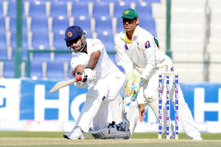 Sri Lankan batsman Prasanna Jayawardene (L) plays a shot as Pakistan wicketkeeper Younis Khan (R) looks on during the final day of the first cricket Test match between Pakistan and Sri Lanka at the Sheikh Zayed Stadium in Abu Dhabi on January 4, 2014. AFP PHOTO/Ishara S. KODIKARA