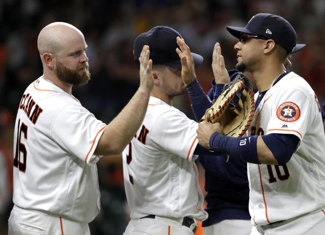 Houston Astros' Yuli Gurriel (10) celebrates with Brian McCann (16) and Alex Bregman (2) after a baseball game against the Arizona Diamondbacks Saturday, Sept. 15, 2018, in Houston. The Astros won 10-4. (AP Photo/David J. Phillip)