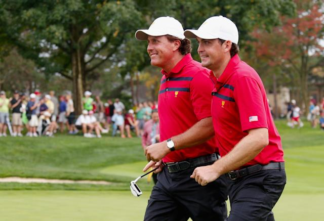 DUBLIN, OH - OCTOBER 05: Phil Mickelson (L) and Keegan Bradley of the U.S. Team celebrate after a birdie on the 13th green during the Day Three Four-ball Matches at the Muirfield Village Golf Club on October 5, 2013 in Dublin, Ohio. (Photo by Gregory Shamus/Getty Images)