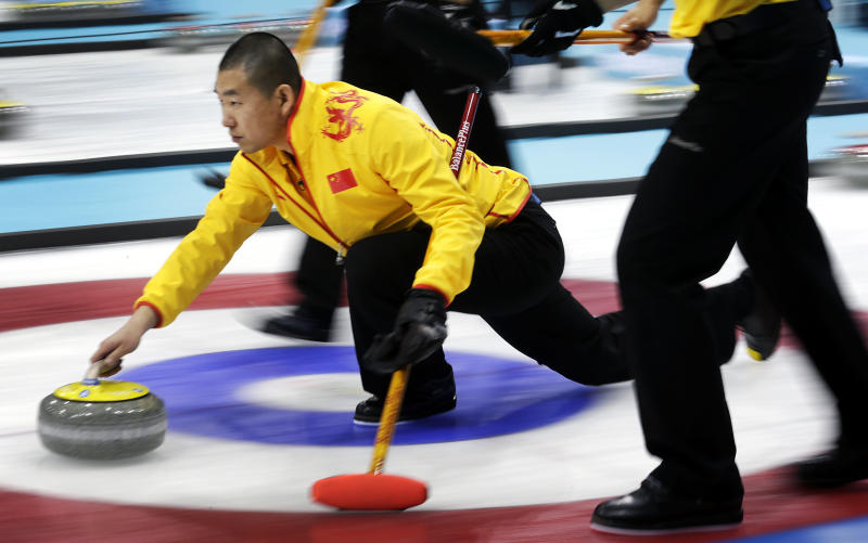 China's skip Liu Rui delivers the rock during the men's curling competition against Germany at the 2014 Winter Olympics, Wednesday, Feb. 12, 2014, in Sochi, Russia. (AP Photo/Wong Maye-E)