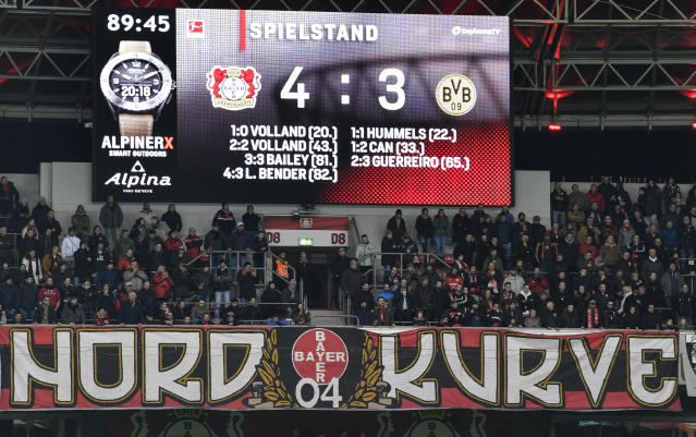 The score board is pictured during the German Bundesliga soccer match between Bayer Leverkusen and Borussia Dortmund in Leverkusen, Germany, Saturday, Feb. 8, 2020. Leverkusen defeated Dortmund with 4-3. (AP Photo/Martin Meissner)