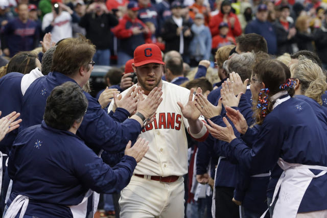 Cleveland Indians' Jason Kipnis gives high-fives during introductions before a baseball game between the Minnesota Twins and the Cleveland Indians, Friday, April 4, 2014, in Cleveland. (AP Photo/Tony Dejak)