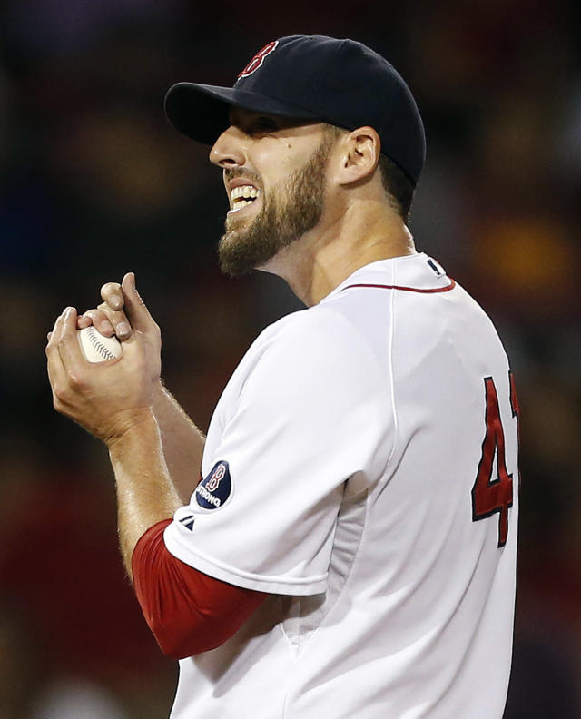 Boston Red Sox's John Lackey reacts after giving up a solo home run to Baltimore Orioles' Adam Jones in the seventh inning of a baseball game in Boston, Thursday, Sept. 19, 2013. (AP Photo/Michael Dwyer)