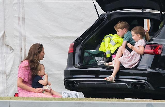 George and Charlotte hang out with their mum and little brother at the charity polo day. (Getty Images)