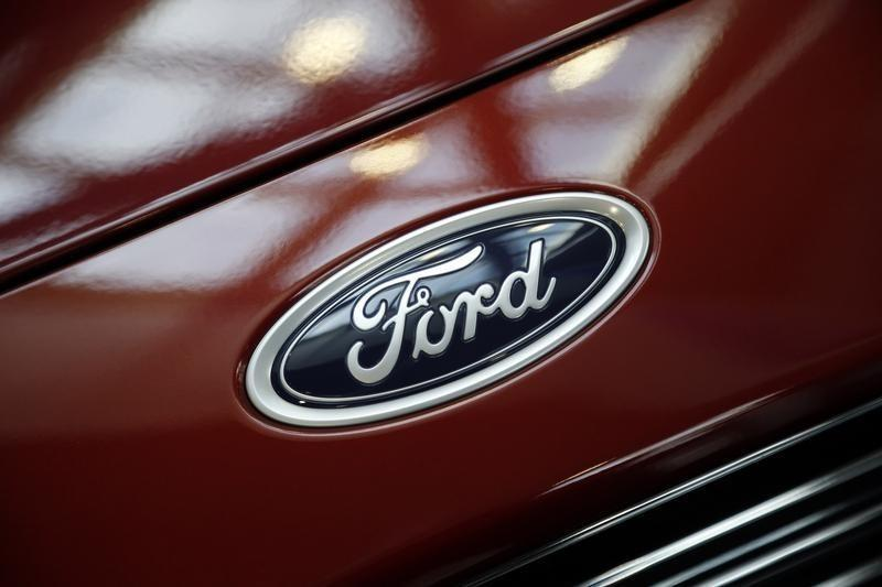 A Ford logo is seen during preparations for the 2014 LA Auto Show in Los Angeles