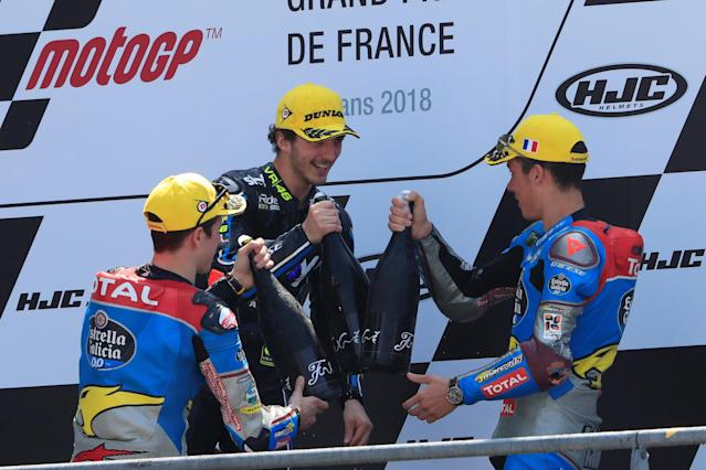 Motorcycling - Moto2 - French Grand Prix - Bugatti Circuit, Le Mans, France - May 20, 2018 SKY Racing Team VR46's Francesco Bagnaia celebrates winning the race as EG 0,0 Marc VDS' Alex Marquez and Joan Mir look on REUTERS/Gonzalo Fuentes