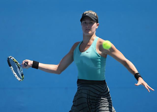 MELBOURNE, AUSTRALIA - JANUARY 13: Eugenie Bouchard of Canada plays a forehand in her first round match against Hao Chen Tang of China during day one of the 2014 Australian Open at Melbourne Park on January 13, 2014 in Melbourne, Australia. (Photo by Renee McKay/Getty Images)