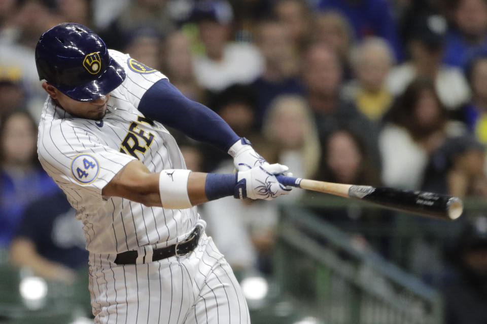 Milwaukee Brewers' Eduardo Escobar hits a two-run single during the third inning of a baseball game against the New York Mets Saturday, Sept. 25, 2021, in Milwaukee. (AP Photo/Aaron Gash)
