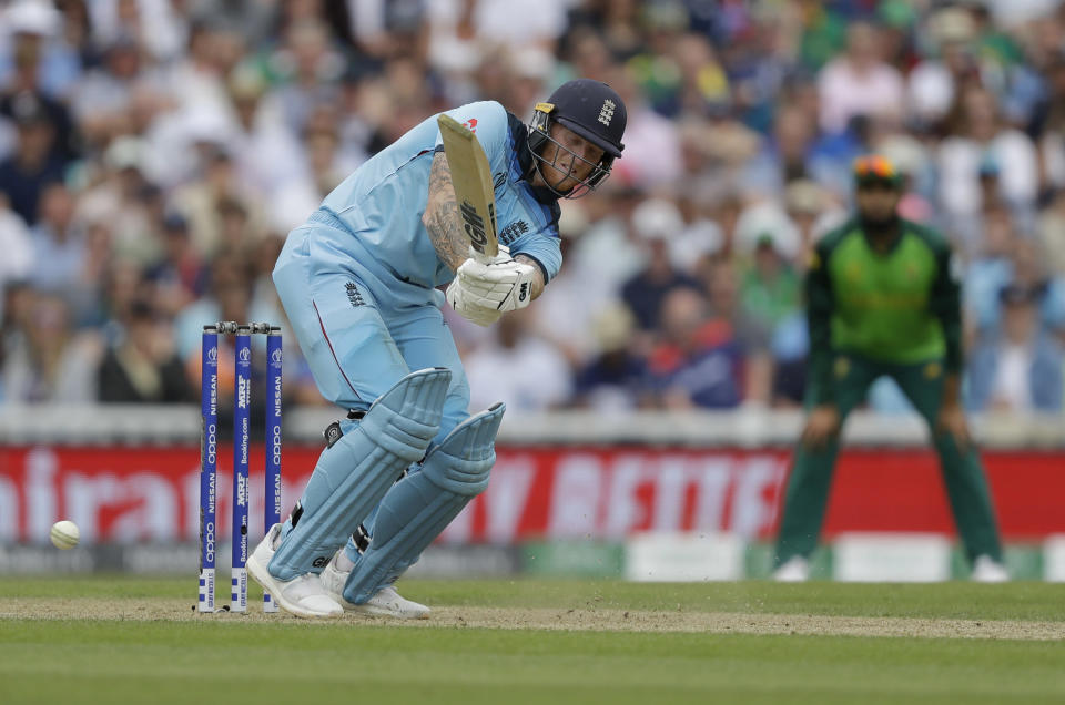 England's Ben Stokes plays a shot off the bowling of South Africa's Kagiso Rabada during the World Cup cricket match between England and South Africa at The Oval in London, Thursday, May 30, 2019. (AP Photo/Kirsty Wigglesworth)