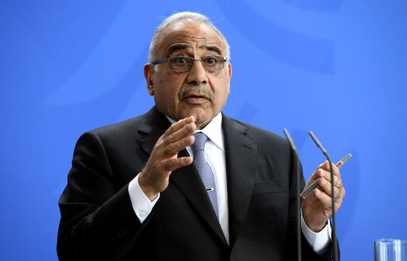 FILE PHOTO: Iraqi Prime Minister Adil Abdul-Mahdi speaks during a news conference with German Chancellor Angela Merkel at the Chancellery in Berlin