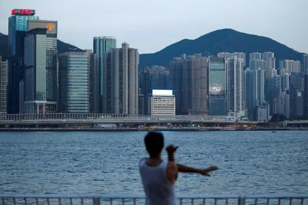 FILE PHOTO: A man excercises at Hung Hom Promenade in Hong Kong