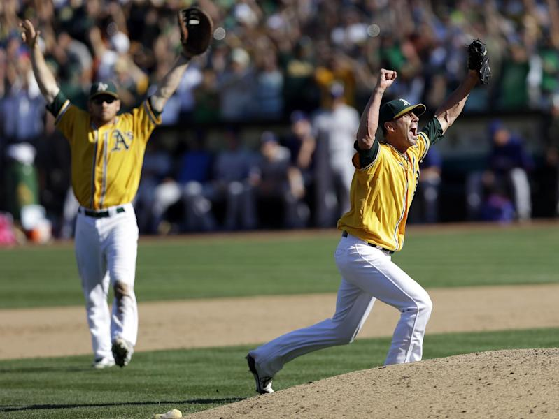 Oakland Athletics relief pitcher Grant Balfour, right, celebrates the last out in their 12-5 win over the Texas Rangers in a baseball game, Wednesday, Oct. 3, 2012 in Oakland, Calif. The A's clinch the AL West title with the win. (AP Photo/Marcio Jose Sanchez)