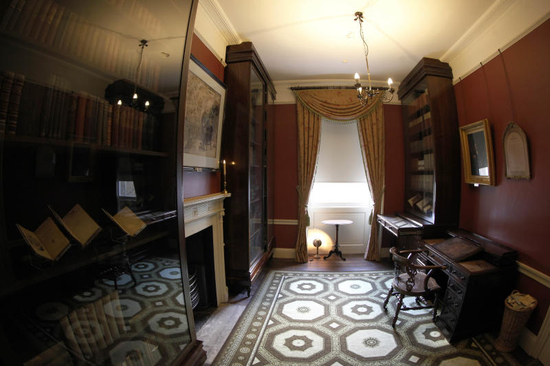 """The study in Charles Dickens' home, part of the Charles Dickens Museum in London, Wednesday, Dec. 5, 2012. For years, the four-story brick row house where the author lived with his young family was a dusty and slightly neglected museum, a mecca for Dickens scholars but overlooked by most visitors to London. Now, after a 3 million pound ($4.8 million) makeover, it has been restored to bring the writer's world to life. Its director says it aims to look """"as if Dickens had just stepped out."""" (AP Photo/Sang Tan)"""