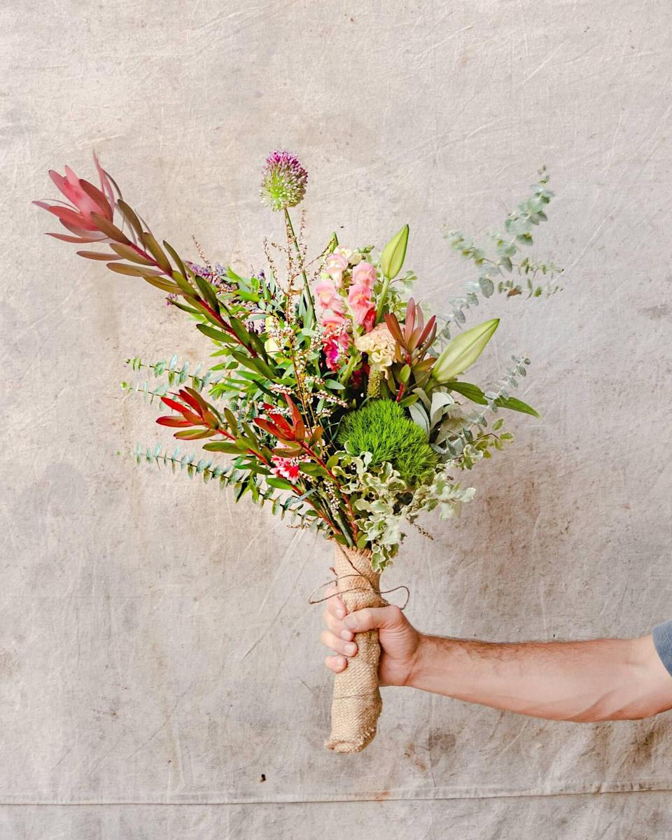 "<p><strong>The Unlikely Florist</strong></p><p>theunlikelyflorist.com</p><p><strong>$80.00</strong></p><p><a href=""https://theunlikelyflorist.com/collections/bouquets/products/the-vernon"" rel=""nofollow noopener"" target=""_blank"" data-ylk=""slk:Shop Now"" class=""link rapid-noclick-resp"">Shop Now</a></p><p>Skip the generic flowers and send her a show-stopping arrangement from this cult-favorite L.A. florist.</p>"
