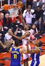 Kawhi Leonard #2 of the Toronto Raptors attempts a lay up against the Golden State Warriors in the first half during Game Five of the 2019 NBA Finals at Scotiabank Arena on June 10, 2019 in Toronto, Canada. (Photo by Vaughn Ridley/Getty Images)