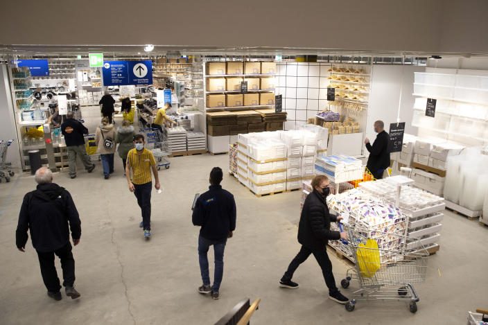 "Customers wearing face masks as a precaution against the spread of coronavirus, in an Ikea store on its reopening day, in Geneva, Switzerland, Monday, March 1, 2021. Swiss authorities last week gave a go-ahead to what they called a ""cautious"" reopening despite a new, more-transmissible COVID-19 variant that first appeared in Britain that is increasingly circulating in the rich Alpine country. (Salvatore Di Nolfi/Keystone via AP)"