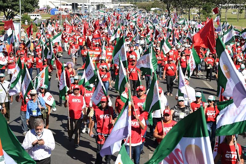 Members of Brazilian social movements march in Brasilia during a national strike against a government's Brazilian Social Welfare reform project on March 15, 2017 (AFP Photo/EVARISTO SA)