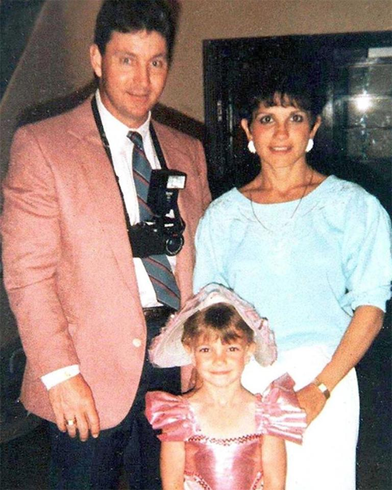"""Oh, baby, baby - she's been adorable since she was a baby! The star could not look any cuter posing between her parents <a href=""""https://people.com/music/britney-spears-father-jamie-spears-not-speaking-remains-conservator/"""">Jamie</a> and Lynn Spears."""