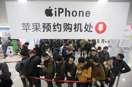 People line up to buy iPhone at a China mobile store in Wuhan