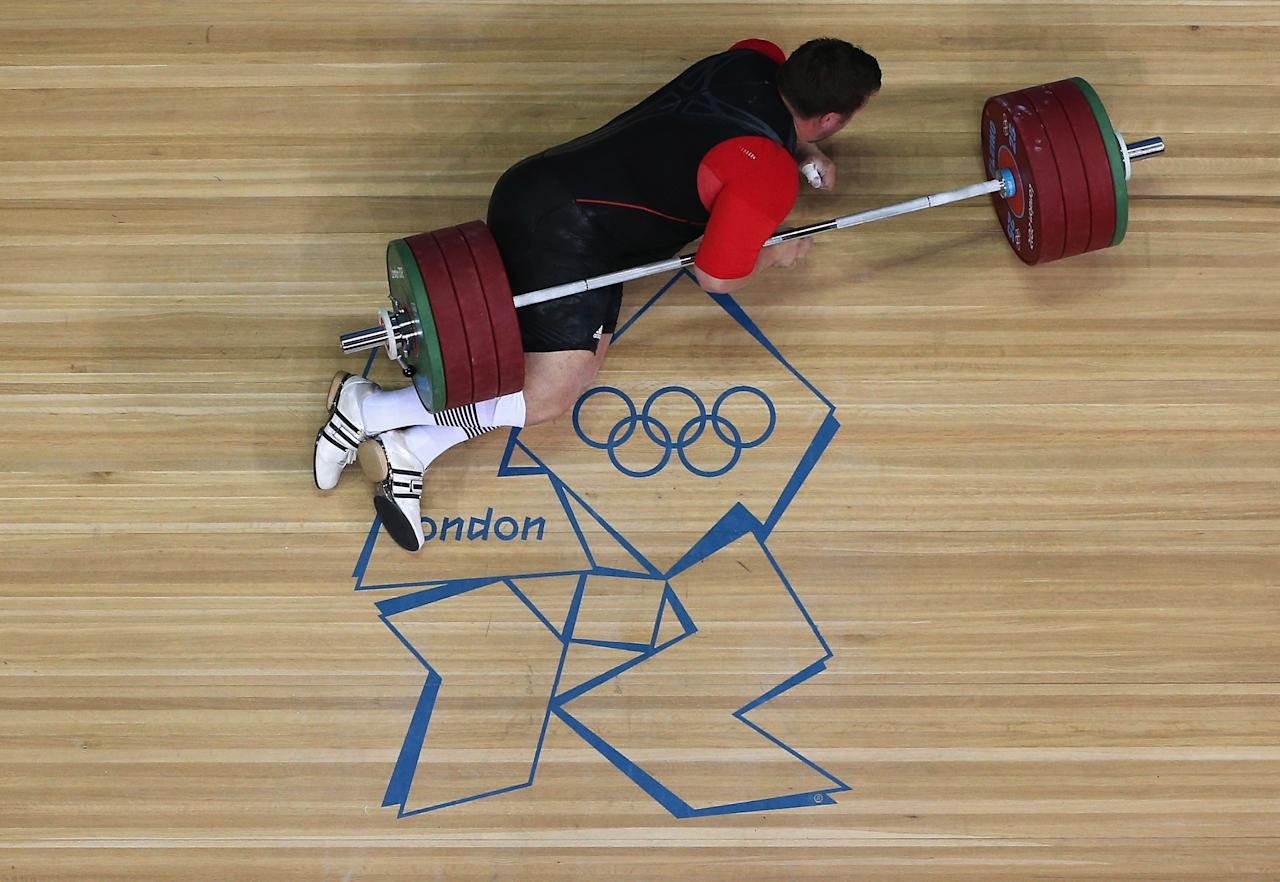 LONDON, ENGLAND - AUGUST 07:  Matthias Steiner of Germany lies on the floor after failing to lift in the Men's +105kg Weightlifting final on Day 11 of the London 2012 Olympic Games at ExCeL on August 7, 2012 in London, England.  (Photo by Richard Heathcote/Getty Images)
