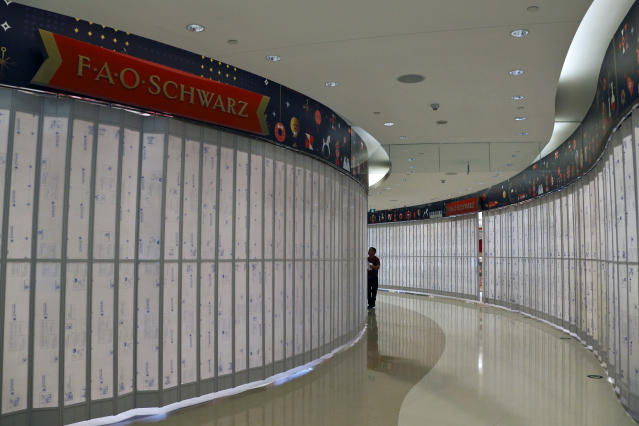 A worker checks on the new upcoming FAO Schwarz toy store at the capital city's popular shopping mall in Beijing, Thursday, May 23, 2019. An escalating trade war between the U.S. and China could mean higher prices on a broad array of products from toys to clothing. But some retailers will be less equipped to handle the pain than others, leaving consumers to carry the load. (AP Photo/Andy Wong)