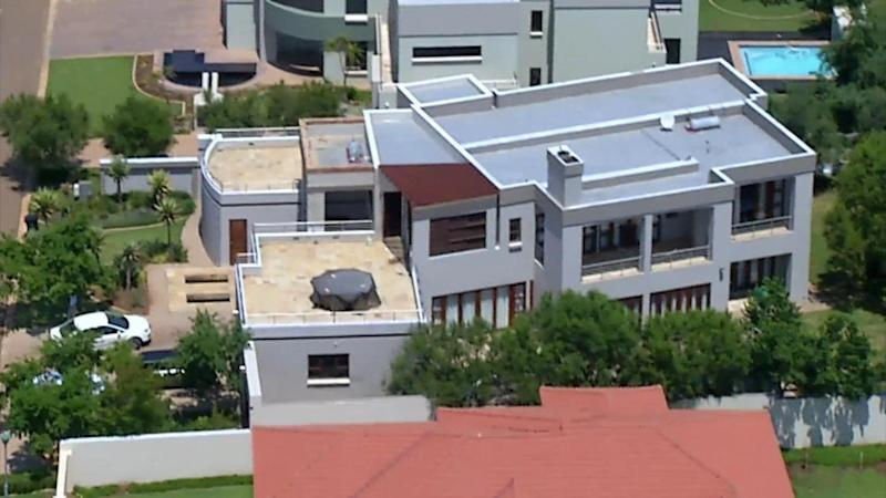 FILE - This file aerial image taken from video and provided by VNS24/7 on Thursday Feb. 14, 2013, shows the home of Olympic athlete Oscar Pistorius in a gated housing complex in Pretoria, South Africa showing balcony and bedroom, top right. Ahead of Pistorius' trail, for the shooting death of his girlfriend Reeva Steenkamp, starting Monday, March 3, 2014, legal experts say Pistorius would still be vulnerable to a homIcide conviction even if he is acquitted of murdering Steenkamp. (AP Photo/VNS24/7-file)