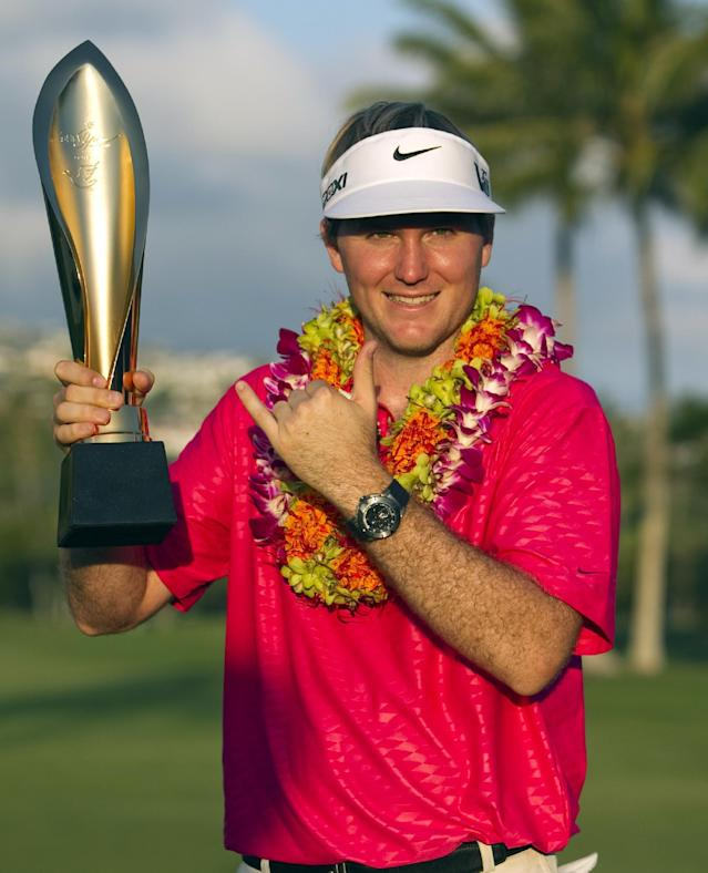 Russell Henley poses with the trophy after winning the Sony Open golf tournament, Sunday, Jan. 13, 2013, in Honolulu. (AP Photo/Marco Garcia)