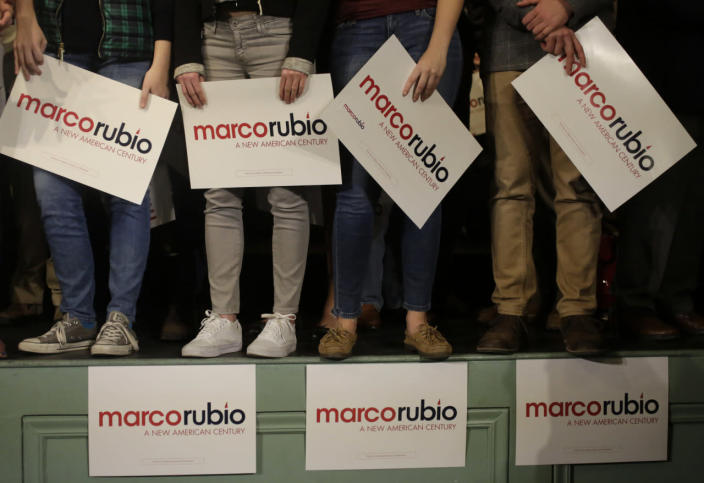 <p>Supporters of Republican presidential candidate Marco Rubio stand onstage and hold placards before a campaign event Tuesday, Feb. 2, 2016, in Exeter, N.H. <i>(Photo: Steven Senne/AP)</i></p>