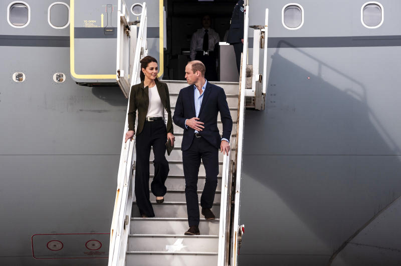 The Duke and Duchess of Cambridge descend from their airplane as they arrive at RAF Akrotiri to celebrate the upcoming Christmas holiday.  (IAKOVOS HATZISTAVROU via Getty Images)