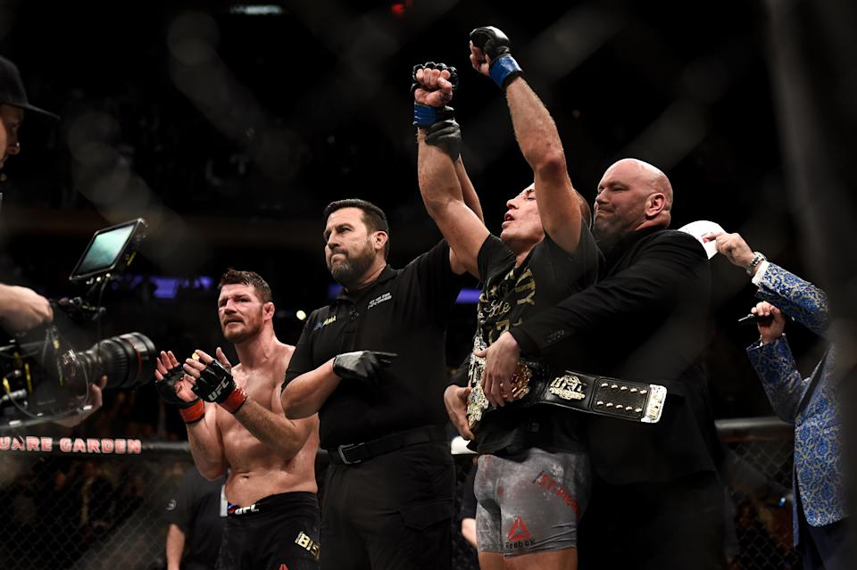 Georges St-Pierre celebrates his submission victory over Michael Bisping in their UFC middleweight championship bout during UFC 217 at Madison Square Garden on Nov. 4, 2017, in New York. (Getty Images)