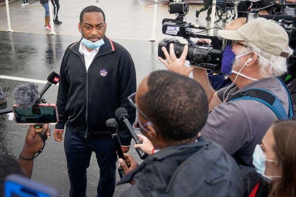 PHOTO: Kentucky State Representative and Democratic candidate for Senate Charles Booker speaks with the press outside the only primary election polling place in Louisville, Ky., June 23, 2020. (Bryan Woolston/Reuters)