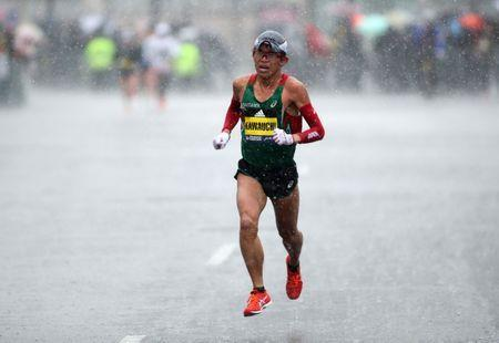 Apr 16, 2018; Boston, MA, USA; Yuki Kawauchi leads the pack during the 2018 Boston Marathon near mile marker 26. Mandatory Credit: Paul Rutherford-USA TODAY Sports