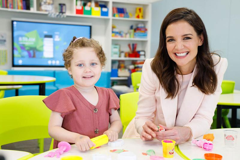 A photo of actor Katie Holmes playing with Play Doh with four-year-old patient Ellie Wild at Ronald McDonald House Westmead.