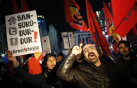 Protesters shout slogans, hold banners and wave flags as they demonstrate against new controls on the Internet approved by Turkish parliament this week in Ankara