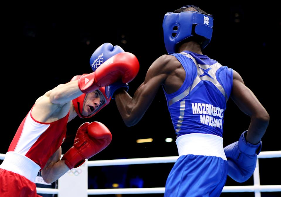 LONDON, ENGLAND - JULY 31: Aleksander Aleksandrov of Bulgaria n(L) in action with Juliano Fernando Gento Maquina of Mozambique on Day 4 of the London 2012 Olympic Games at ExCeL on July 31, 2012 in London, England. (Photo by Scott Heavey/Getty Images)