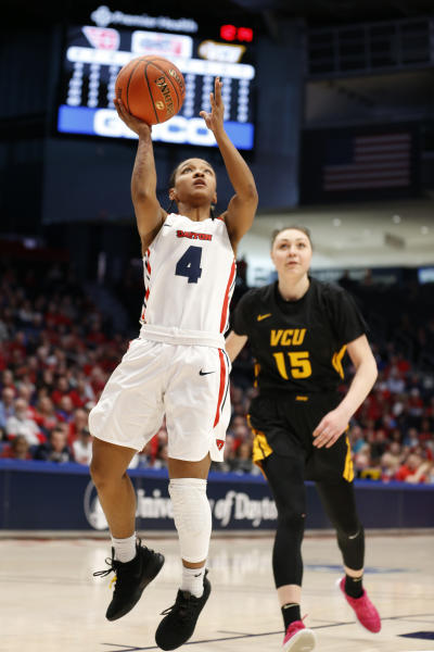 Dayton guard Shakeela Fowler (4) shoots in front of Virginia Commonwealth center Sofya Pashigoreva (15) during the first half of the women's Atlantic 10 championship NCAA college basketball game, Sunday, March 8, 2020, in Dayton, Ohio. (AP Photo/Gary Landers)