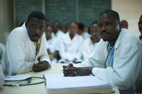 """<span class=""""caption"""">Many doctors and healthcare staff feel the need to practice in richer countries that offer a more stable politics, better education and opportunities for their families.</span> <span class=""""attribution""""><a class=""""link rapid-noclick-resp"""" href=""""https://commons.wikimedia.org/wiki/File:Pediatric_doctors_at_Donka_hospital_reviewing_mealses_cases.jpg"""" rel=""""nofollow noopener"""" target=""""_blank"""" data-ylk=""""slk:Julien Harneis"""">Julien Harneis</a>, <a class=""""link rapid-noclick-resp"""" href=""""http://creativecommons.org/licenses/by-sa/4.0/"""" rel=""""nofollow noopener"""" target=""""_blank"""" data-ylk=""""slk:CC BY-SA"""">CC BY-SA</a></span>"""