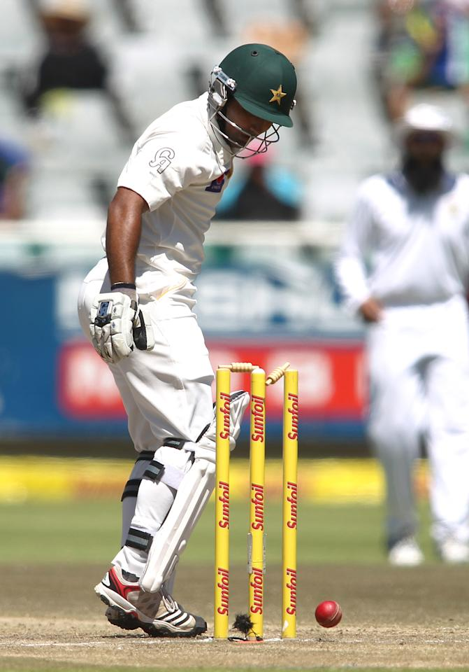 CAPE TOWN, SOUTH AFRICA - FEBRUARY 17:  Asad Shafiq of Pakistan watches as the ball hits the wickets during day 4 of the 2nd Sunfoil Test match between South Africa and Pakistan at Sahara Park Newlands on February 17, 2013 in Cape Town, South Africa. (Photo by Shaun Roy/Gallo Images/Getty Images)