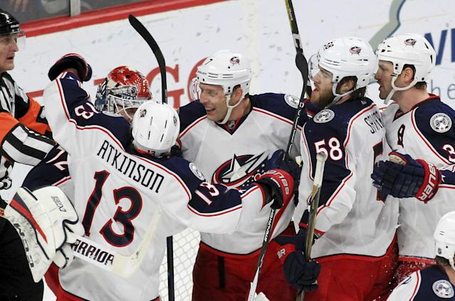 "<a class=""link rapid-noclick-resp"" href=""/nhl/teams/cob/"" data-ylk=""slk:Columbus Blue Jackets"">Columbus Blue Jackets</a> goalie <a class=""link rapid-noclick-resp"" href=""/nhl/players/4901/"" data-ylk=""slk:Sergei Bobrovsky"">Sergei Bobrovsky</a> (72) is congratulated by teammates <a class=""link rapid-noclick-resp"" href=""/nhl/players/5282/"" data-ylk=""slk:Cam Atkinson"">Cam Atkinson</a> (13), <a class=""link rapid-noclick-resp"" href=""/nhl/players/3777/"" data-ylk=""slk:Jack Johnson"">Jack Johnson</a> (7), David Savard (58) and Boone Jenner (38) after the Blue Jackets defeated the <a class=""link rapid-noclick-resp"" href=""/nhl/teams/min/"" data-ylk=""slk:Minnesota Wild"">Minnesota Wild</a> 4-2 during an NHL hockey game Saturday, Dec. 31, 2016, in St. Paul, Minn. (AP Photo/Andy Clayton-King)"