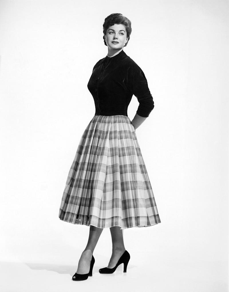 The actress wears a plaid skirt in this photo from the 1950s.