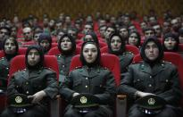 Newly trained female officers from the Afghan National Army sit in front seats as a new batch of officers attend their graduation ceremony at National Army's training center in Kabul, Afghanistan, Thursday, Sept. 23, 2010. (AP Photo/Gemunu Amarasinghe)
