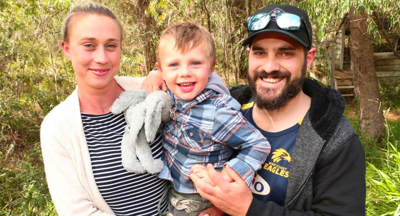 James is pictured with his mum and dad after being found alive and well in dense bushland