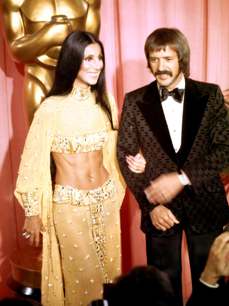 The singer flouted convention at the 1973 Oscars in a dazzling two-piece. Instead of a dress, she arrived wearing a midriff bearing ensemble that perfectly reflected the singer's trailblazing style.