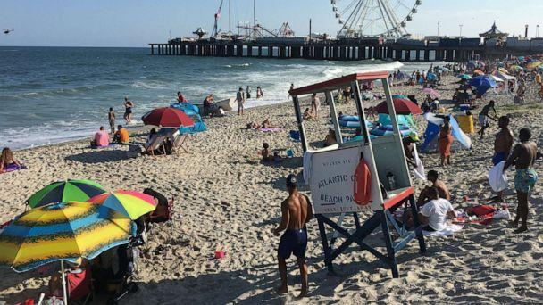 PHOTO: People gather on the beach in Atlantic City, N.J., for Independence Day holiday weekend, July 4, 2020. (SMXRF/starmaxinc.com via Newscom)