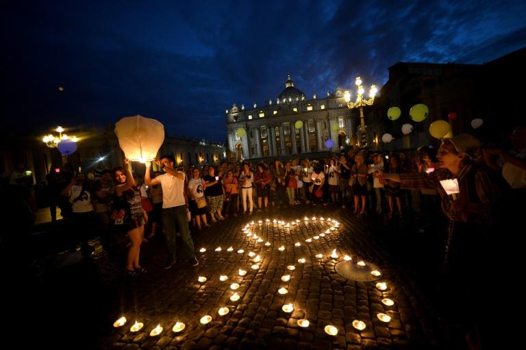 In 2013, demonstrators commemorated the 30th anniversary of Emanuela Orlandi's disappearance, in Saint Peter's Square at the Vatican (AFP Photo/Filippo MONTEFORTE)