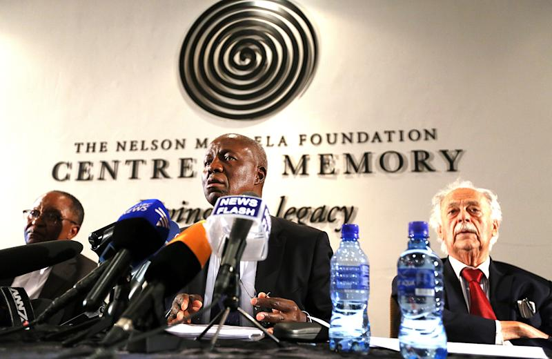 South Africa's deputy chief justice Dikgang Moseneke, center, speaks as Advocate George Bizos, right, and Prof. Njabulo Ndebele, left, look on during their media briefing after a will was read in its entirety to members of Mandela's family at the Nelson Mandela Foundation in Johannesburg, South Africa, Feb. 3, 2014. The Nelson Mandela Foundation Nelson Mandela's estate is worth roughly $4.1 million, excluding royalties and other amounts, and beneficiaries of his will include his family, members of his staff, schools that he attended and the African National Congress, the movement that fought white rule and now governs South Africa, the will's executors said Monday. (AP Photo/STR)