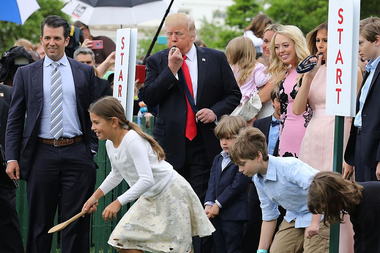 <p>President Trump, center, and first lady Melania Trump, second from right, along with members of the first family, watch as the president blows the whistle to begin an Easter Egg Roll race on the South Lawn of the White House in Washington, Monday, April 17, 2017, during the annual White House Easter Egg Roll. (Photo: Chip Somodevilla/Getty Images) </p>