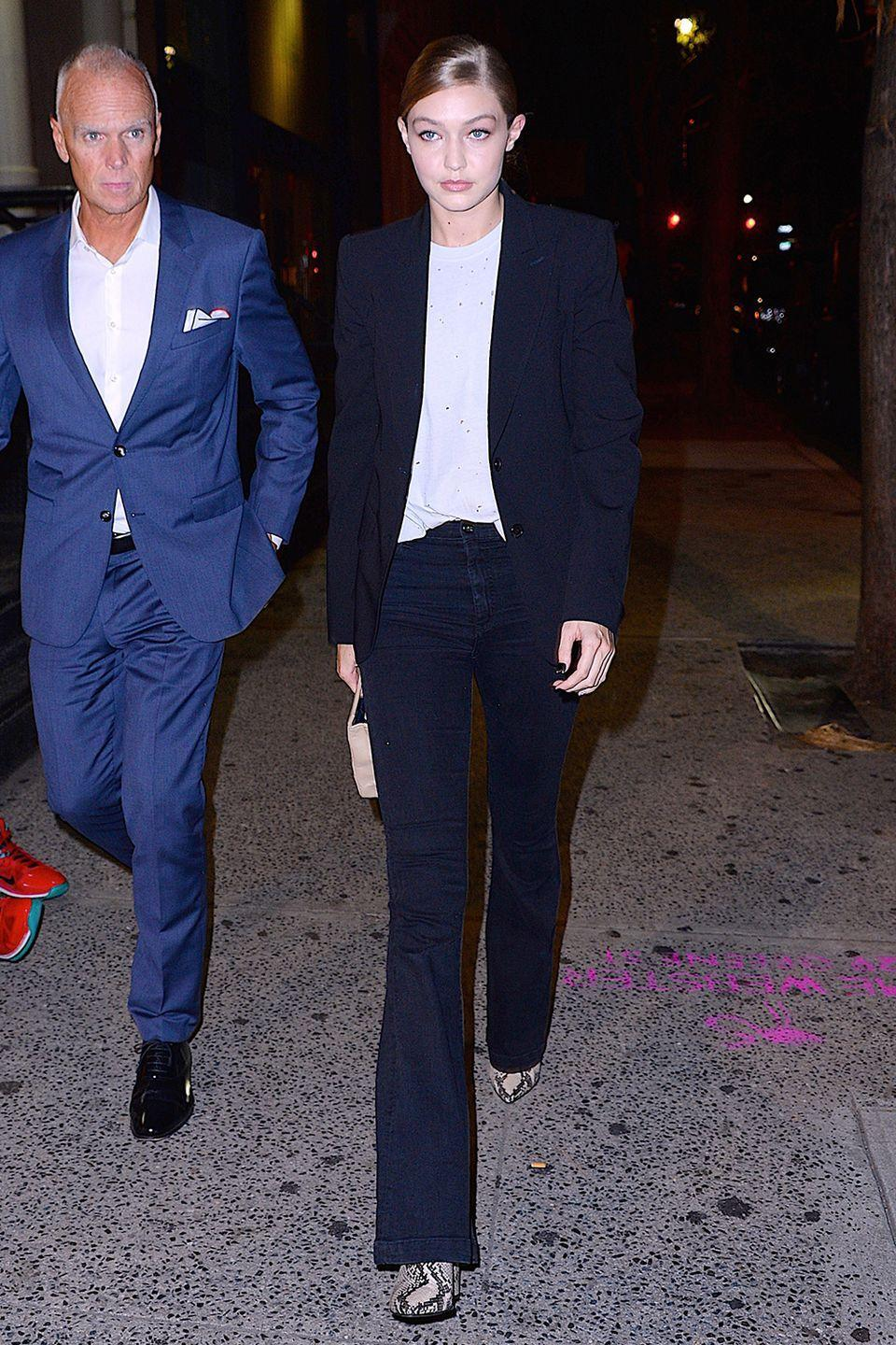<p>In blue jeans, a navy blazer, white t-shirt, and snakeskin boots out in NYC. </p>