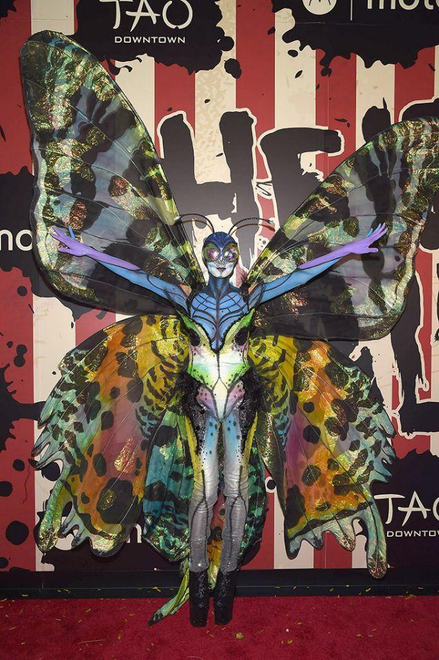 <p>No. 1: In 2014, Klum really spread her wings, morphing into an amazing butterfly. But not just any butterfly — one with prosthetics, body makeup, and enormous, colorful wings, which took five hours to apply. The result was simply stunning, even though she couldn't see very well. It's our all-time favorite for execution (because of the sheer amount work that went into it), but she should also get props for spending all night in a club wearing that getup. Do you know how many people must have knocked her wings? It will be very hard to top this in 2017, but we know she'll keep trying. (Photo: Gary Gershoff/WireImage) </p>